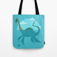 "earthbound Tote Bags featuring Loch""Ness"" Monster by Michael B. Myers Jr."