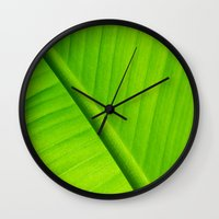 banana leaf Wall Clocks featuring Upclose Banana Leaf by Erin Mac Photography