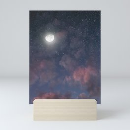 Glowing Moon on the night sky through pink clouds Mini Art Print