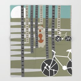Biking in the woods Throw Blanket