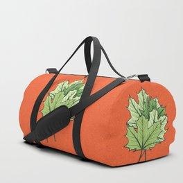 Green Maple Leaves On Vibrant Orange Duffle Bag