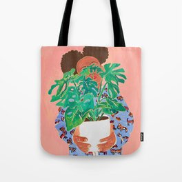 Adventure Stories for Introverts: Lethabo and the Delicious Monster, Woman with Indoor Plant Painting on Pink Tote Bag