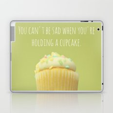 You can't be sad when you're holding a cupcake. Laptop & iPad Skin