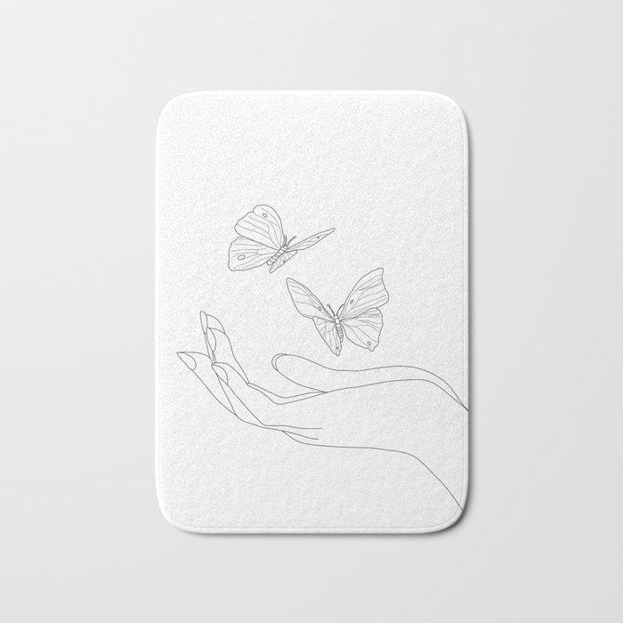 Butterflies on the Palm of the Hand Bath Mat