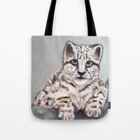 snow leopard Tote Bags featuring Snow Leopard by RakMeowww