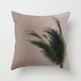 Nude Beach - A photograph of a palm tree against a peach sky Throw Pillow