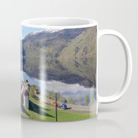 greg guillemin Mugs featuring Norway Fjords - Greg Katz by Artlala for MSF Doctors Without Borders