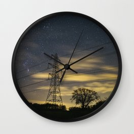 Electricity pylons, stars and clouds. West Acre, Norfolk, UK. Wall Clock