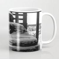 buddah Mugs featuring Snowy Buddah by Nearlycanadian
