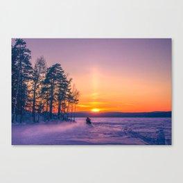 The snow mobile race toward the Sun pillar Canvas Print