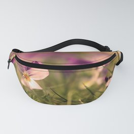 Viola flowers on a meadow Fanny Pack