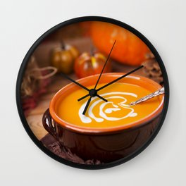 Creamy pumpkin soup on a rustic table Wall Clock