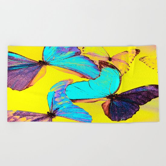 Shiny and colorful butterflies Beach Towel