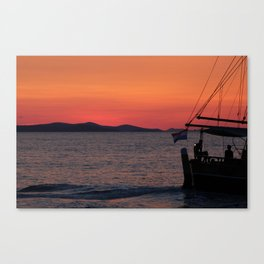 Beautiful sunset in Zadar with a boat Canvas Print