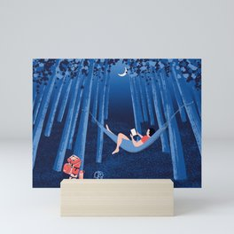 Reading alone in the woods at night Mini Art Print