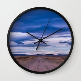 Wind and empty roads in Patagonia. Wall Clock
