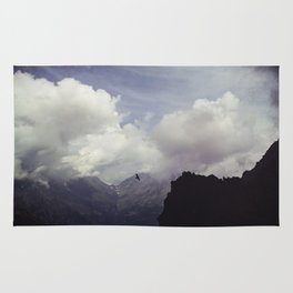 clouds over mountains Rug