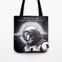 interstellar Tote Bags featuring interstellar by Saalk