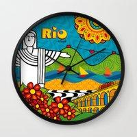 rio de janeiro Wall Clocks featuring Rio de Janeiro 2015 by Monica Fuchshuber