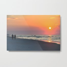 Couple walking on the beach at sunrise holding hands Metal Print