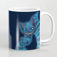 cheshire cat Mugs featuring Cheshire cat by trevacristina