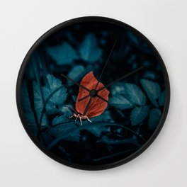 Red in the dark Wall Clock