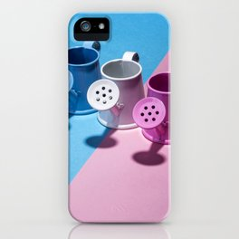 Three small watering cans on a colored background iPhone Case
