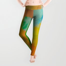 splash painting texture abstract background in green brown blue yellow Leggings