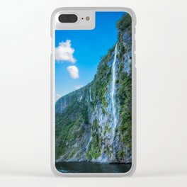 One of the numerous waterfalls falling down the sheer cliffs at Milford Sound. Clear iPhone Case