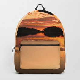 Beautiful sunset - glowing orange - forest silhouette and reflection Backpack