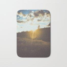 sunset slanted in a field Bath Mat