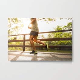 Motion blur. Young man is running on bridge sunrise in the morning at public park Metal Print