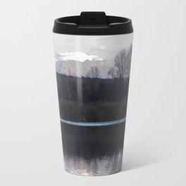 A lake in the mountains Travel Mug
