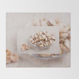 open pistachio nuts in shell Throw Blanket
