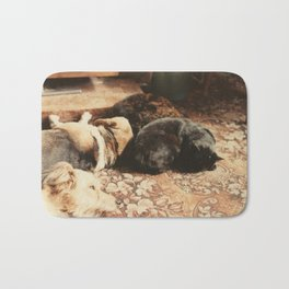 Cats and dogs sleeping on the carpet Bath Mat