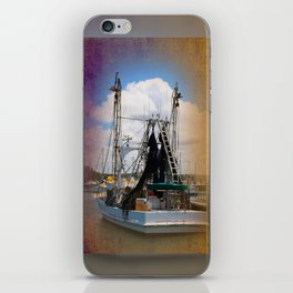 Moored boat on a river iPhone Skin