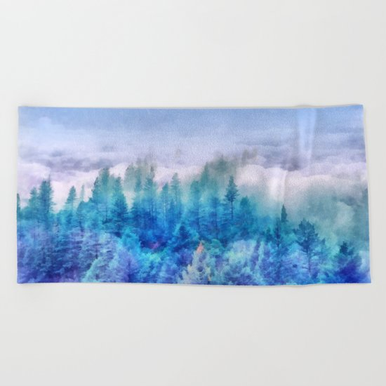 Clouds over pine forest Beach Towel