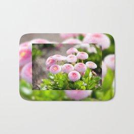 Bellis perennis pomponette flowers Bath Mat