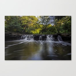 Waterfall in the morning sun Canvas Print