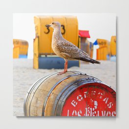 Seagull on the beach on a wooden barrel Metal Print