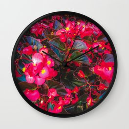 closeup red flowers with yellow pollen and green leaves Wall Clock
