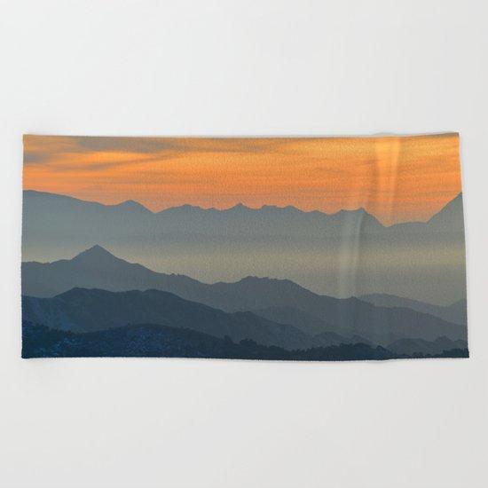 Mountains. Foggy sunset Beach Towel