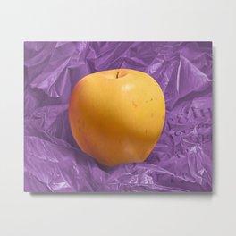 Apple on purple plastic bag Metal Print