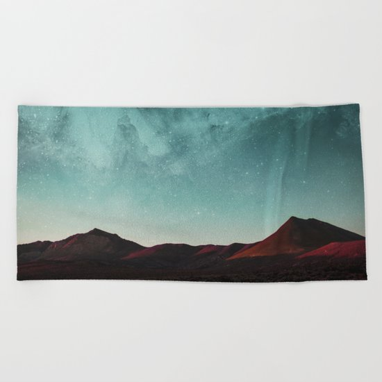 Universe above the mountain peaks Beach Towel