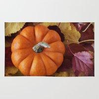 pumpkin Area & Throw Rugs featuring Pumpkin  by brushnpaper