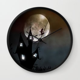 Drawing of a witch leaving her house on a broom in front of a full moon Wall Clock