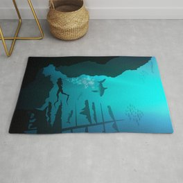 Beautiful coral reef and silhouettes of diver and school of fish in a blue sea Rug