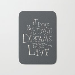 It does not do to dwell on dreams Bath Mat