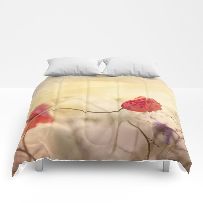 Poppy flower and sunset Comforters