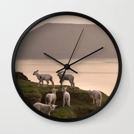 Little lambs on a cliff Wall Clock